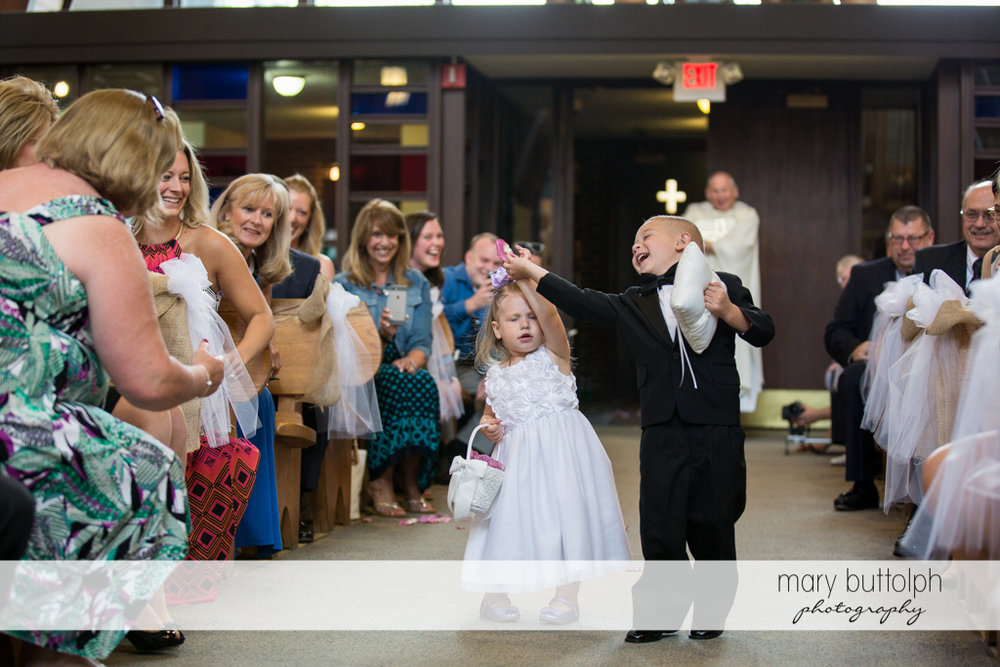 Young boy and girl clown around as guest look on at the Lodge at Welch Allyn Wedding