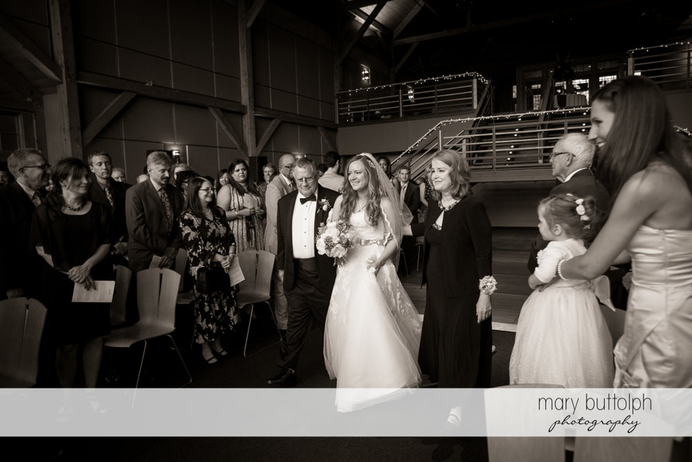 Bride and her father approach the marriage officiant at the Lodge at Welch Allyn Wedding