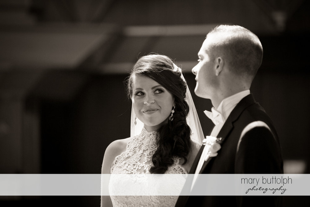 Couple look at each other at the Lodge at Welch Allyn Wedding