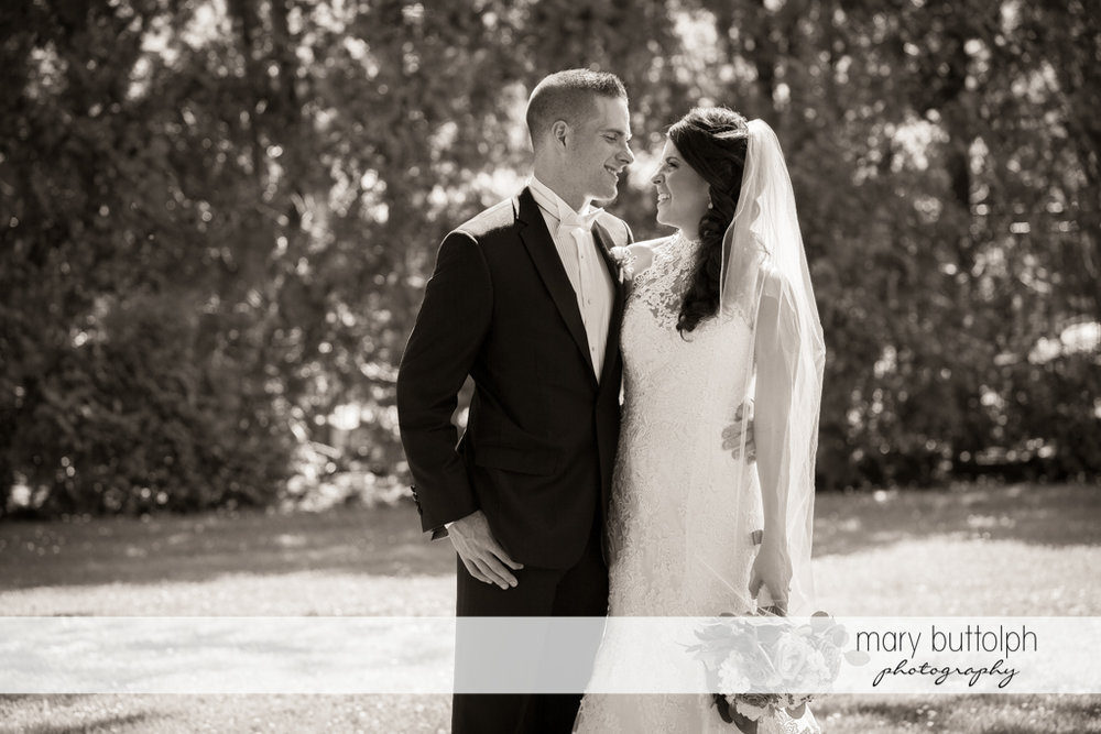 Couple in a dramatic black and white shot in the garden at the Lodge at Welch Allyn Wedding