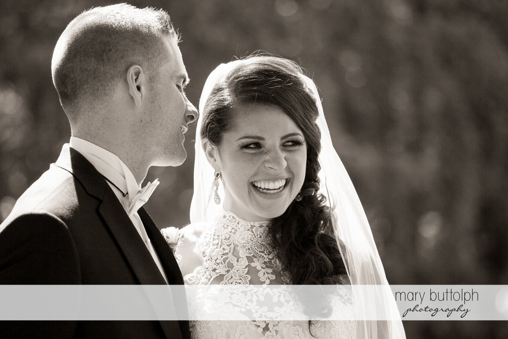 Happy couple in a black and white shot at the Lodge at Welch Allyn Wedding