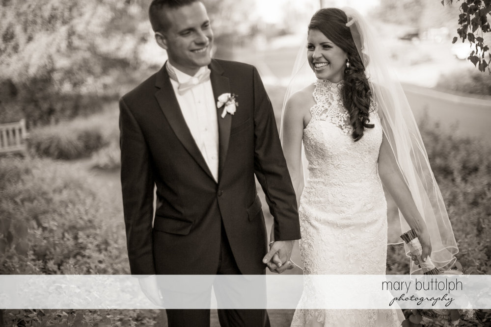 Couple take a stroll in the garden at the Lodge at Welch Allyn Wedding