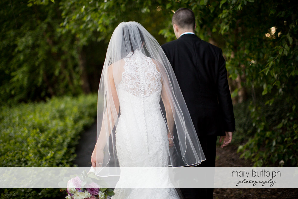 Couple walk together in the garden at the Lodge at Welch Allyn Wedding