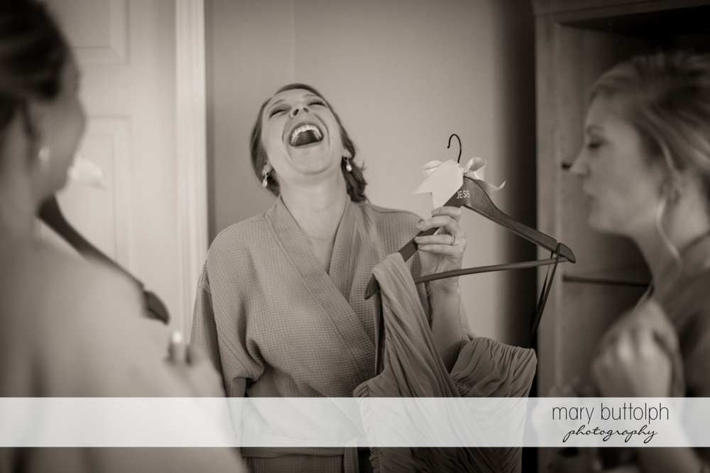 Bride finds something funny at the Lodge at Welch Allyn Wedding