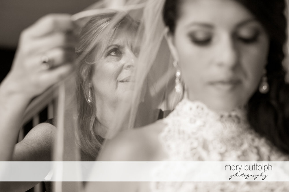 Bride's mother adjusts her daughter's wedding veil at the Lodge at Welch Allyn Wedding