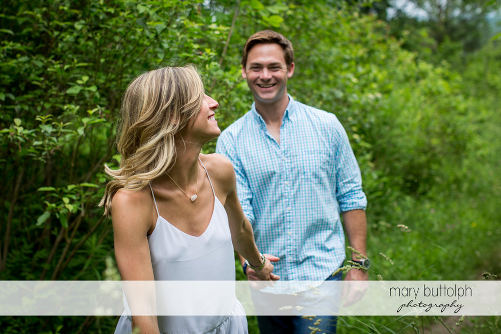 Couple explore the park at Skaneateles Engagement