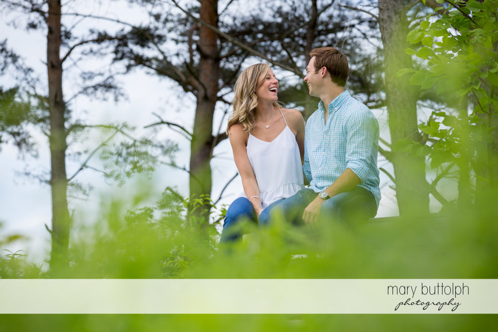 Couple take a break in the park at Skaneateles Engagement
