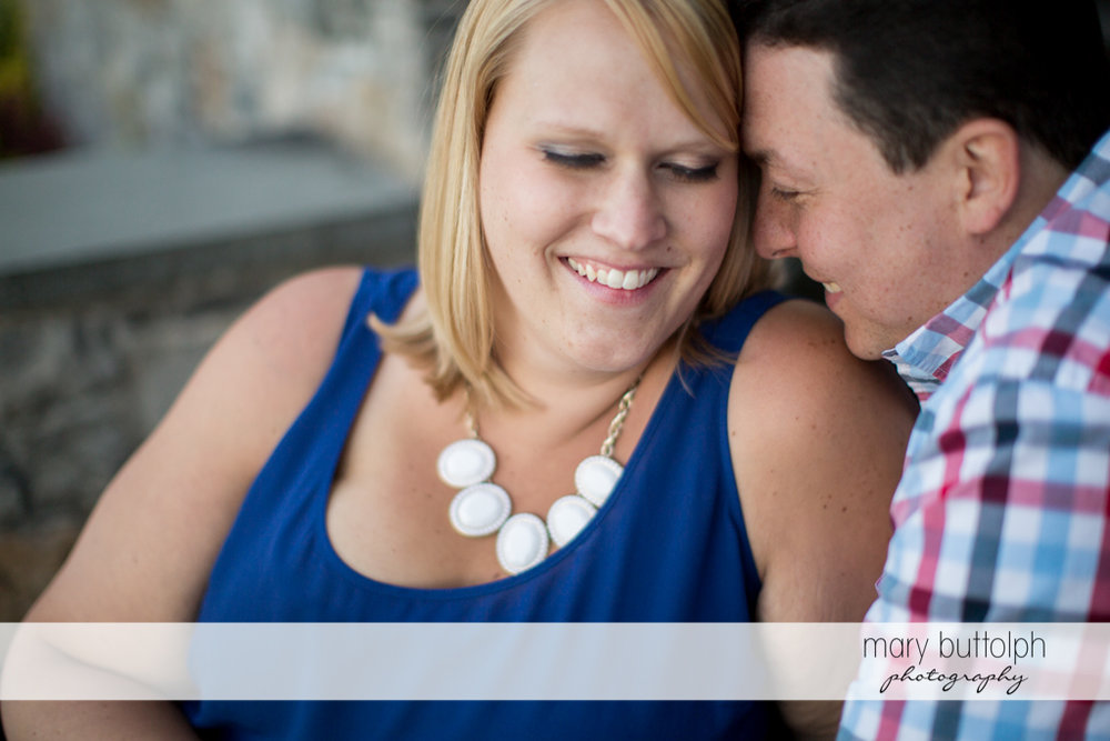 Couple share an intimate moment at Skaneateles Lake Engagement