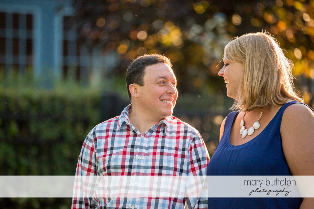 Couple enjoy a quiet stroll at Skaneateles Lake Engagement