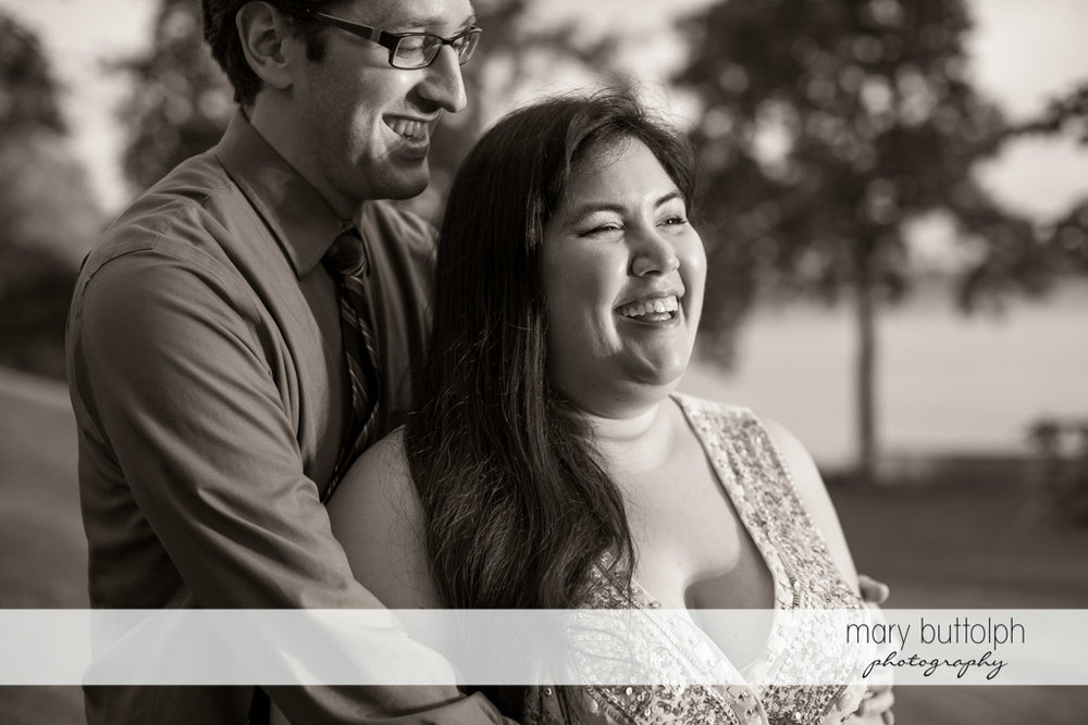 Couple share a laugh in the garden at Aurora Inn Engagement