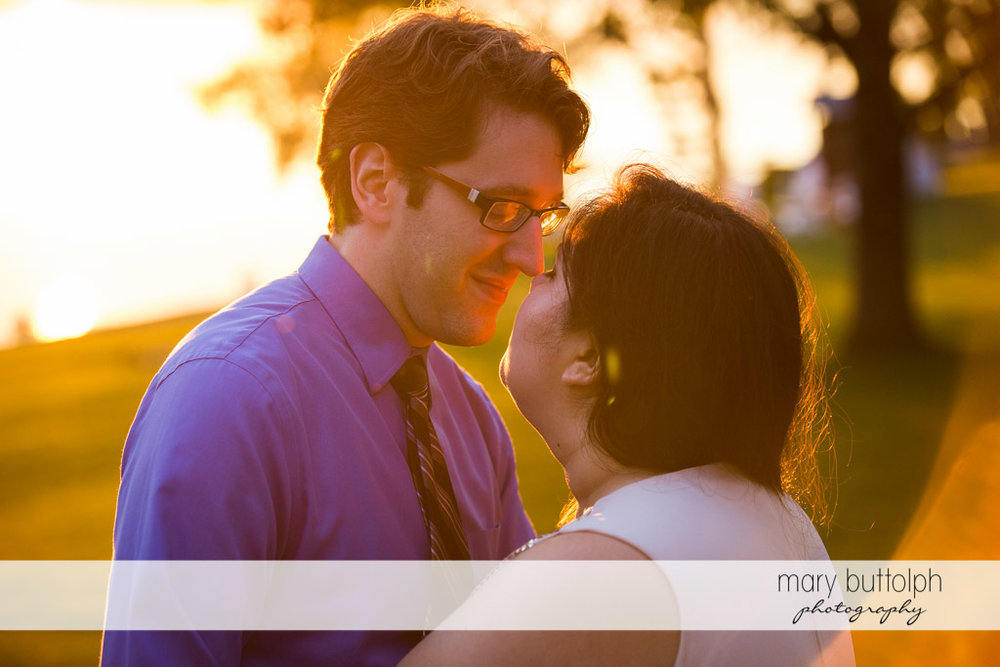 Couple in a tender moment as the sun sets at Aurora Inn Engagement