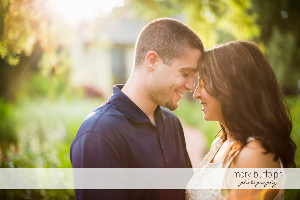 Couple pose in the garden at Skaneateles Engagement