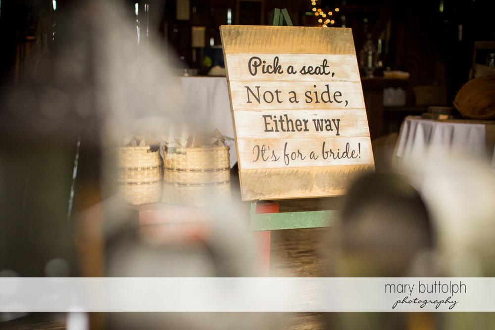 Funny sign greets guests at the wedding venue at Mandana Barn Wedding