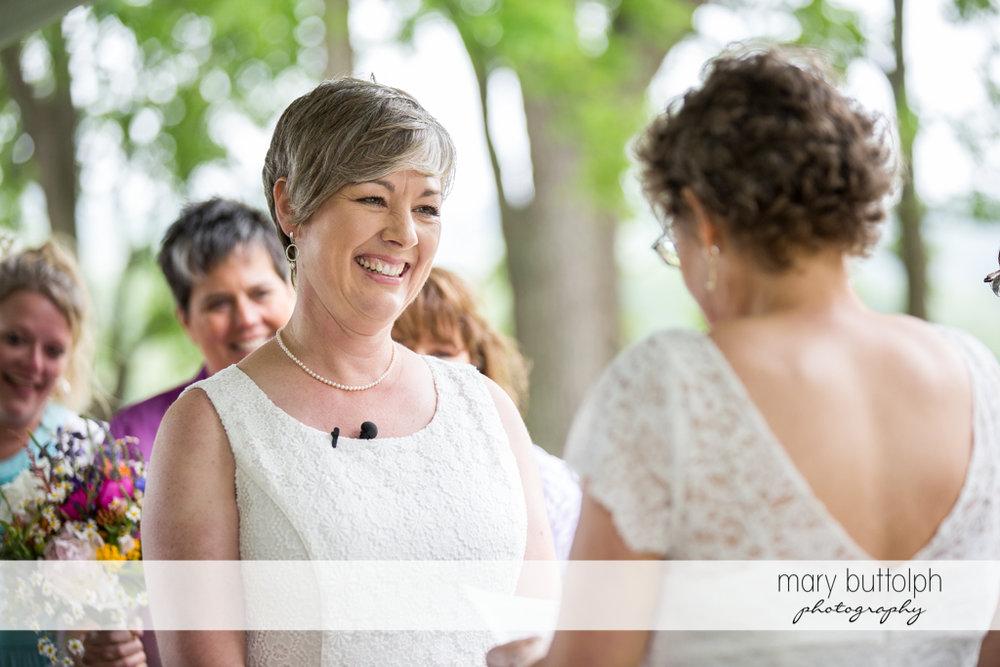 Same sex couple face each other at Mandana Barn Wedding