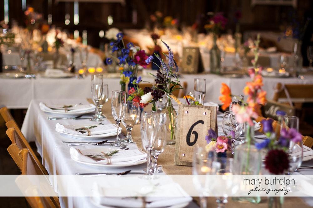 Tables await guests at the wedding venue at Mandana Barn Wedding