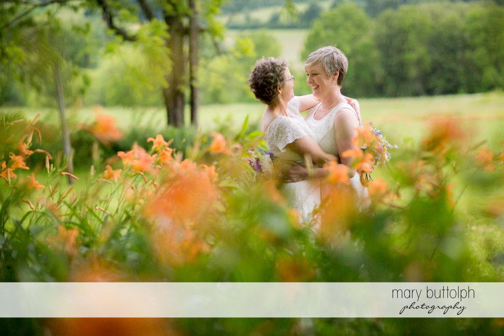 Couple embrace in the garden at Mandana Barn Wedding