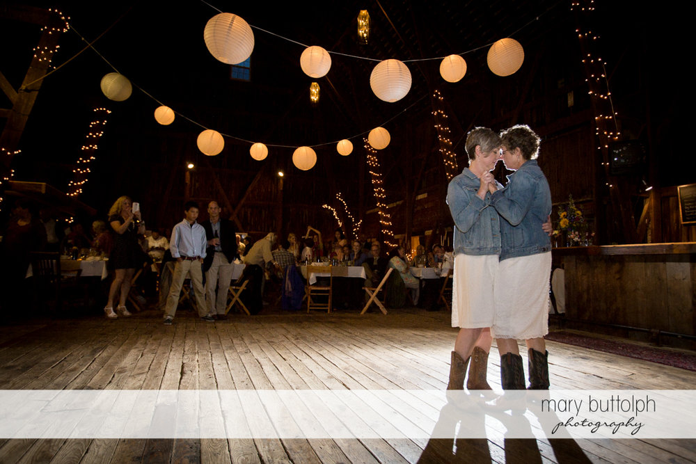 Same sex couple in a romantic dance at Mandana Barn Wedding