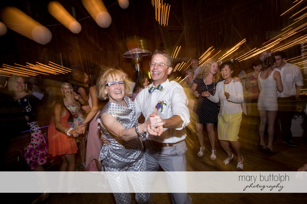 Guests of same sex couple dance the night away at the wedding venue at Mandana Barn Wedding