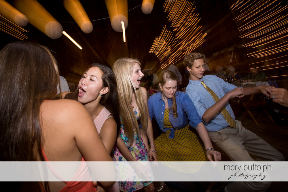 Guests show their dance moves at Mandana Barn Wedding