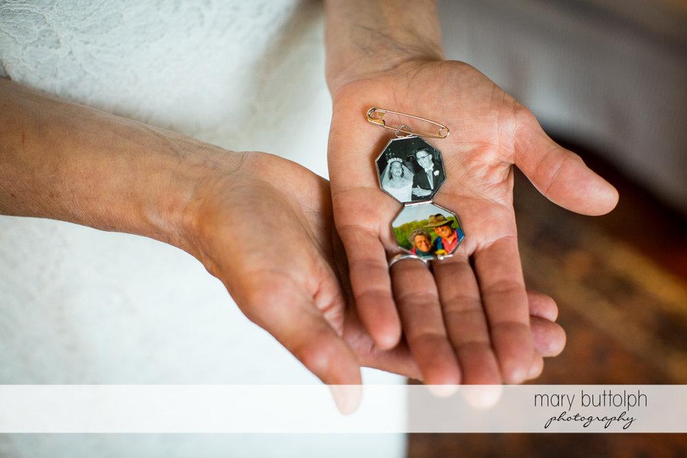 Bride shows photos of her parents at Mandana Barn Wedding
