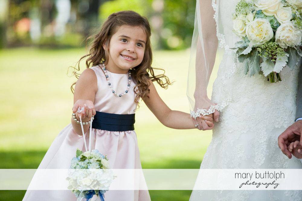 Smiling flower girl in the garden at the Inns of Aurora Wedding