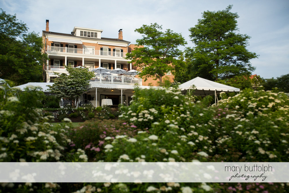 View of the wedding venue surrounded by flowers at the Inns of Aurora Wedding
