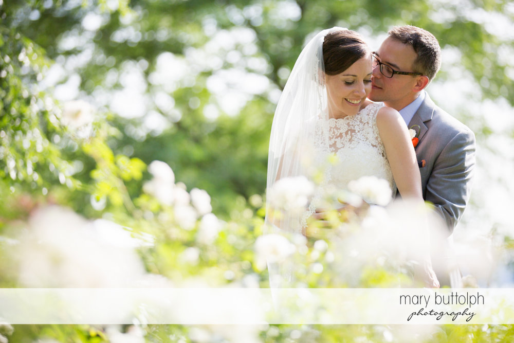 Couple enjoy the sunlight in the garden at the Inns of Aurora Wedding