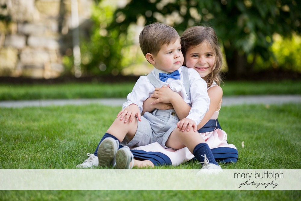 Young boy and girl sit in the garden at the Inns of Aurora Wedding