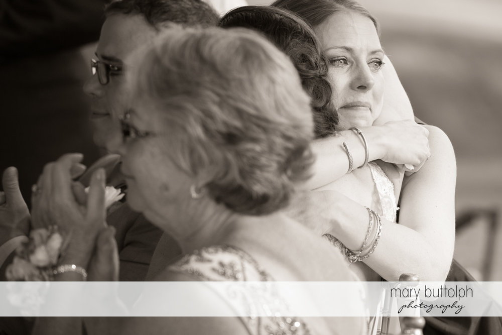 Guests embrace during the wedding at the Inns of Aurora Wedding