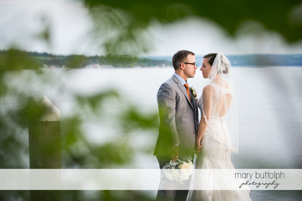 Couple pose by the lake at the Inns of Aurora Wedding