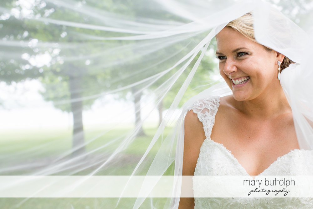 Happy bride with her long wedding veil at Emerson Park Pavilion Wedding