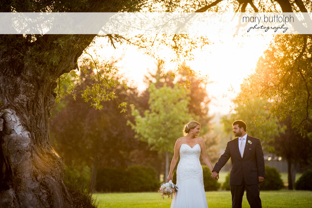 Couple stroll in the garden at Emerson Park Pavilion Wedding