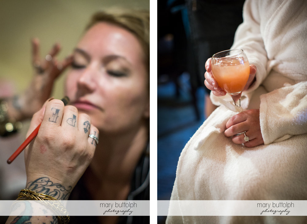 Close up shot of tattooed hand of the makeup artist and bride holding a glass of orange juice at Emerson Park Pavilion Wedding