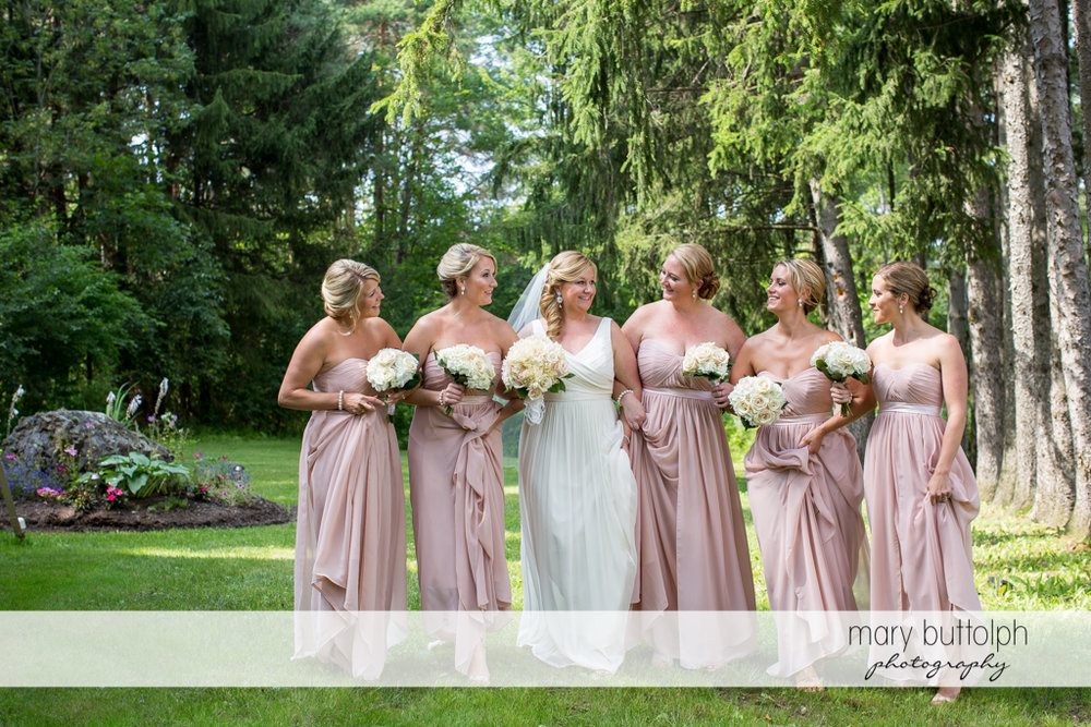 Bride and her bridesmaids in the woods at Emerson Park Pavilion Wedding