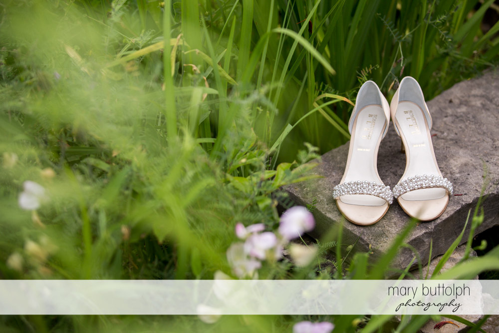 Bride's wedding shoes in the garden at Emerson Park Pavilion Wedding