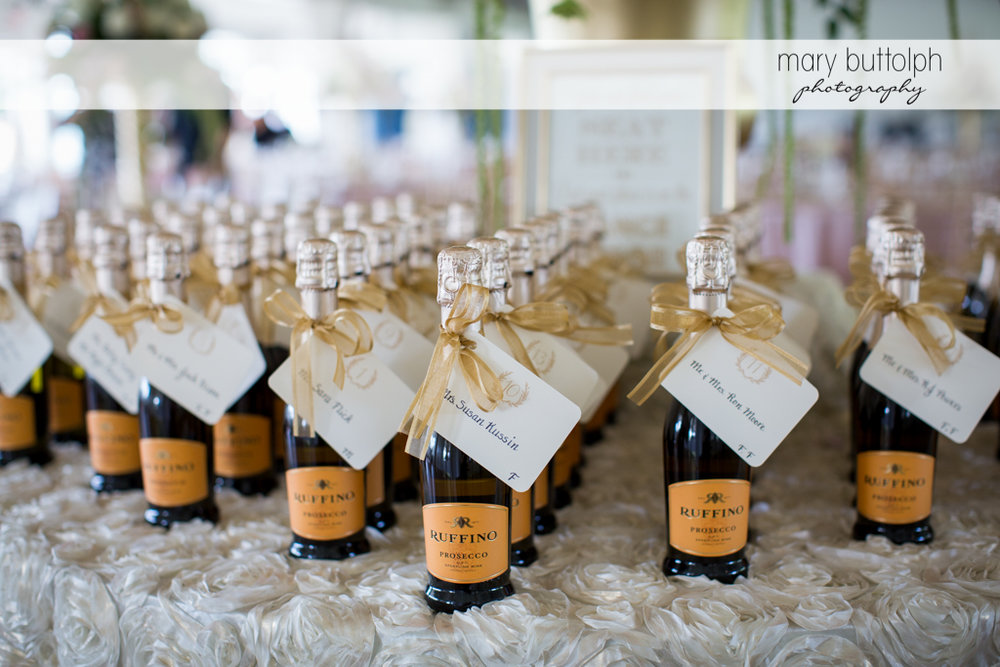 Bottles of Italian wine await guests at the wedding reception at Emerson Park Pavilion Wedding