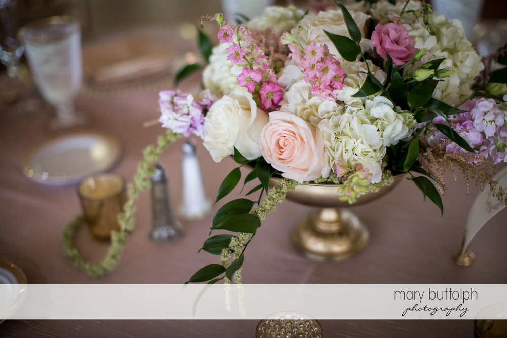Bouquets add beauty to the dining area at Emerson Park Pavilion Wedding