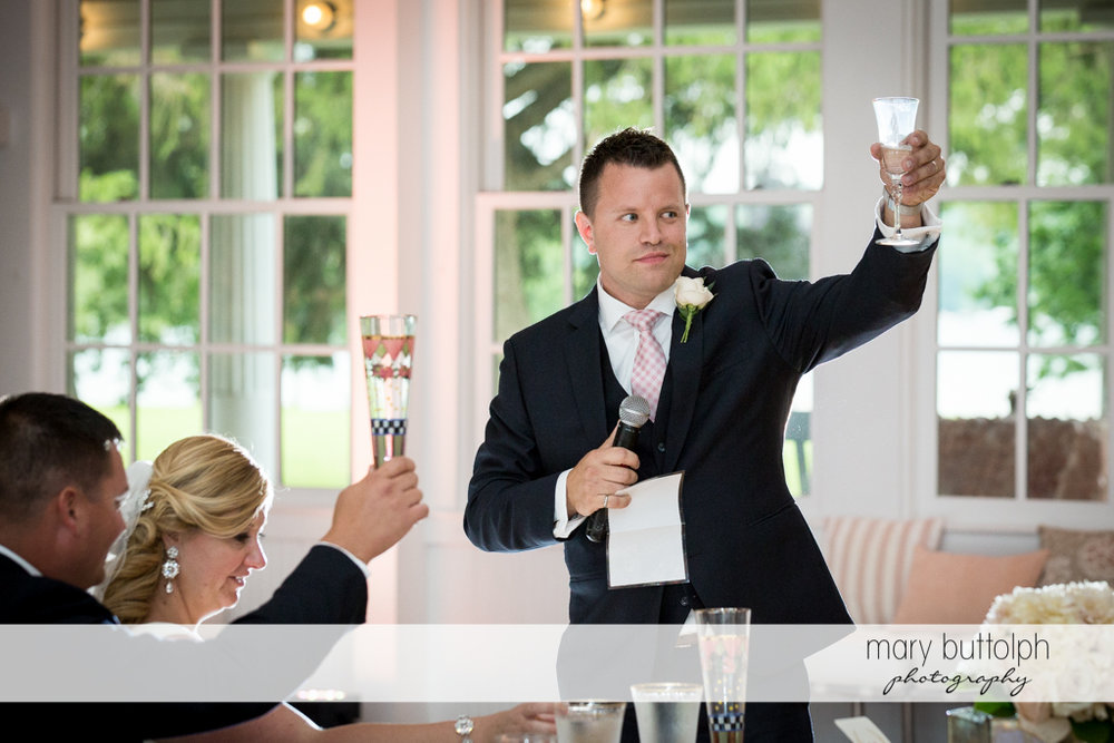 Guests make a toast to the newlyweds at Emerson Park Pavilion Wedding