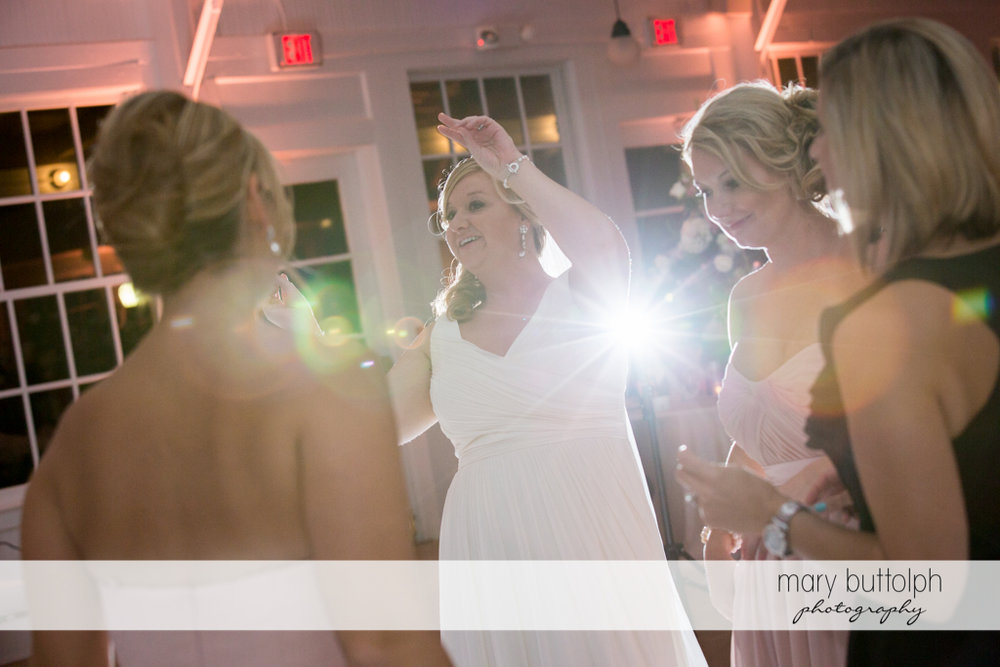 Brides calls the attention of a guest at Emerson Park Pavilion Wedding