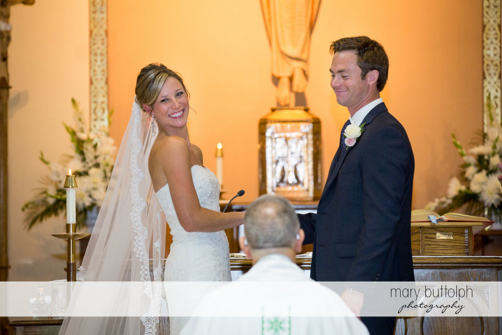 Couple smile at guests in front of the altar at Skaneateles Country Club Wedding