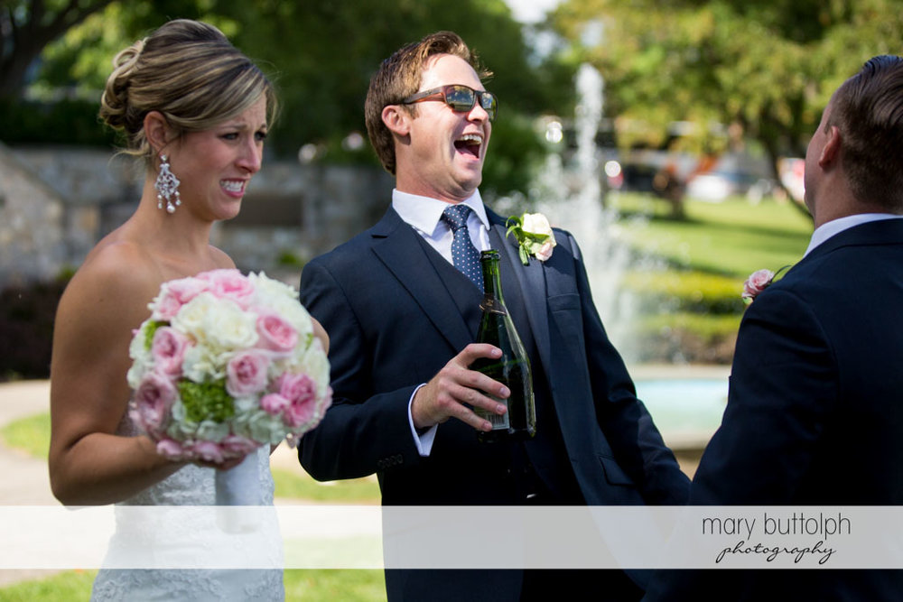 Couple share a happy moment with one of the guests at Skaneateles Country Club Wedding