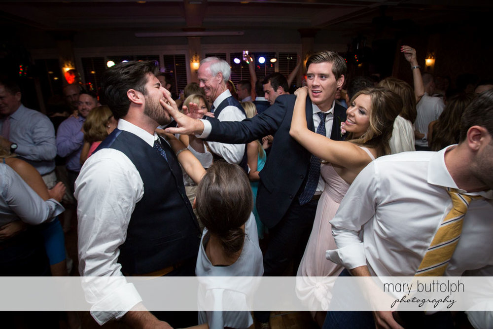 Groomsmen clown around on the dance floor at Skaneateles Country Club Wedding