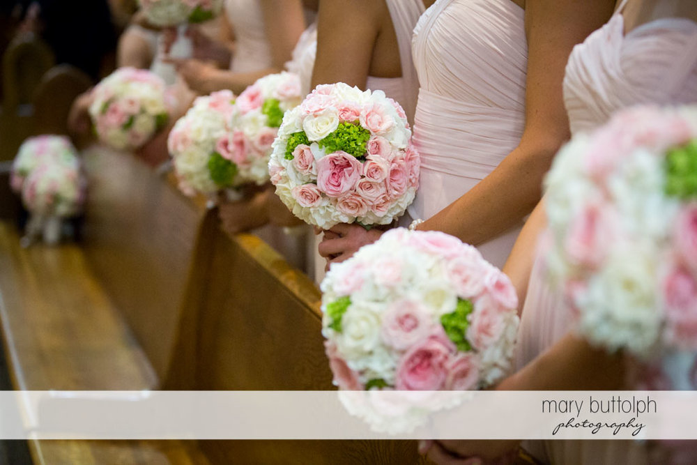 Bridesmaids holding bouquets in church at Skaneateles Country Club Wedding