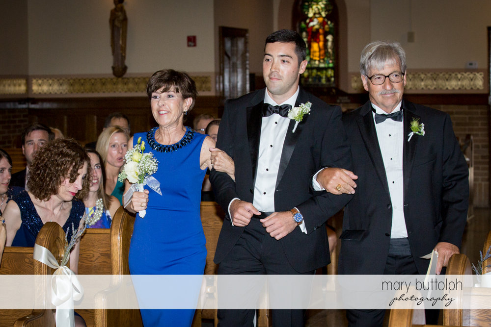 Groom and his parents walk down the aisle at Skaneateles Country Club Wedding