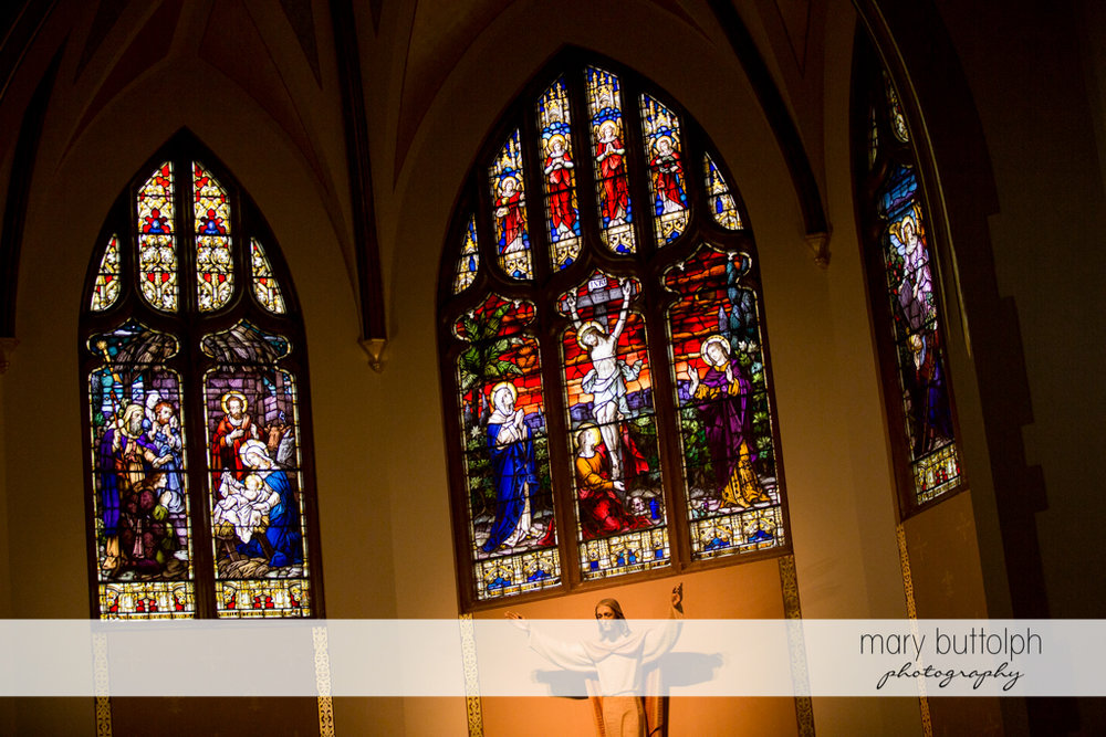 Stained glass windows show the birth and death of Christ at Skaneateles Country Club Wedding