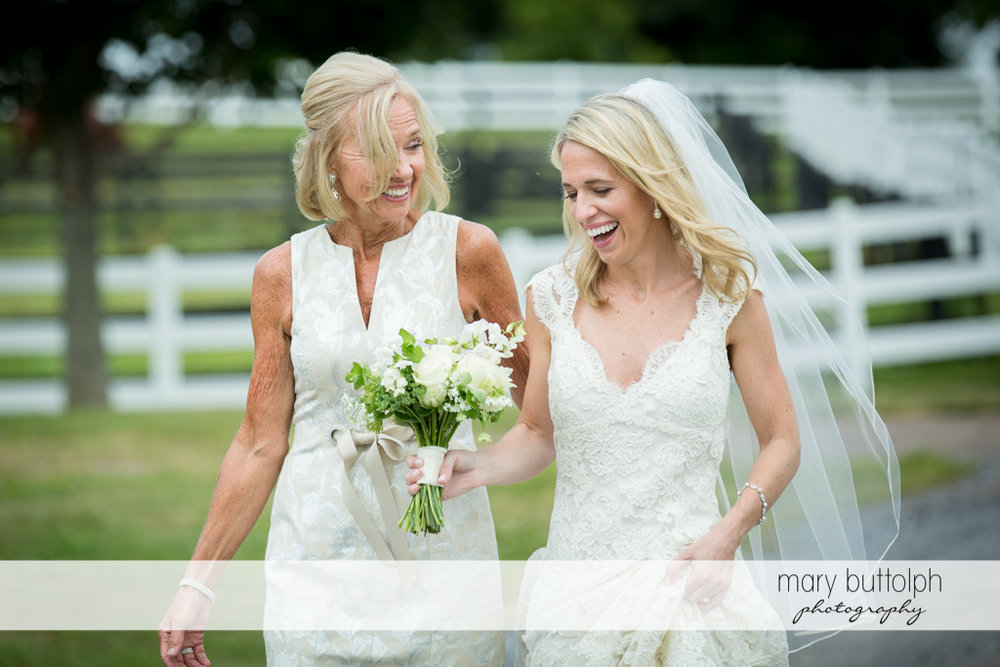 Bride and her mom laugh in the garden at Skaneateles Country Club Wedding