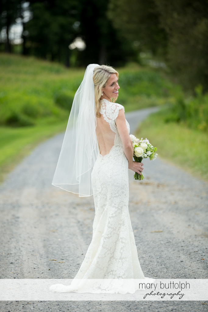 Bride on the road at Skaneateles Country Club Wedding