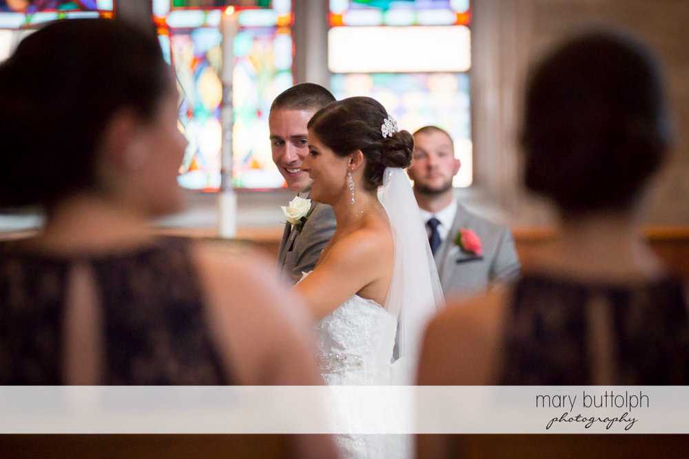 Couple approach the altar at Turning Stone Resort Casino Wedding