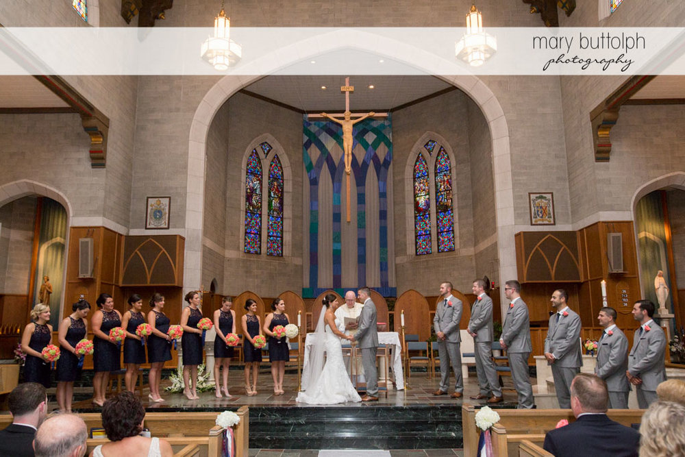 The wedding party with the priest at the altar at Turning Stone Resort Casino Wedding