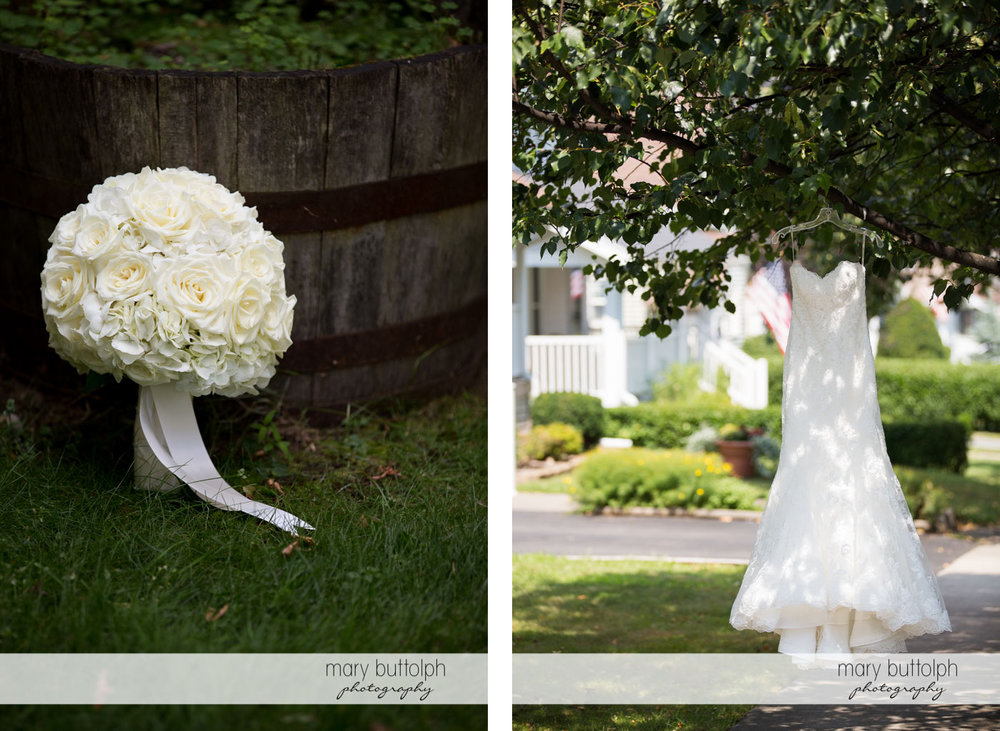 Bride's white bouquet stands near an old bucket while her wedding dress hangs from a tree at Turning Stone Resort Casino Wedding